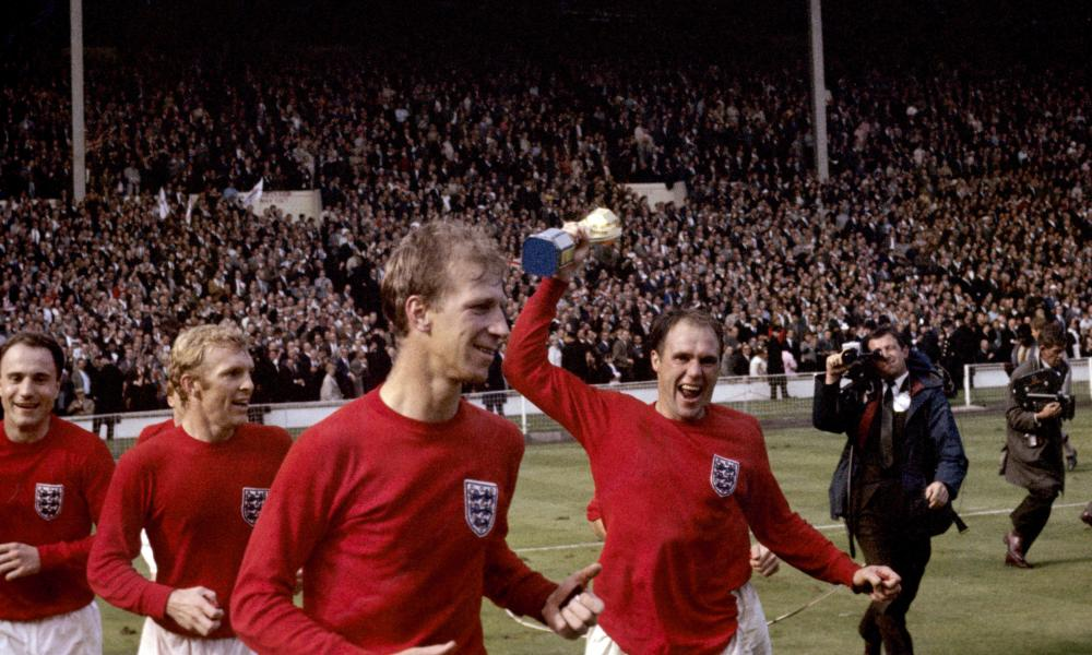 Left to right: England's George Cohen, Bobby Moore, Jack Charlton and Ray Wilson (with trophy) celebrate after winning the 1966 World Cup.