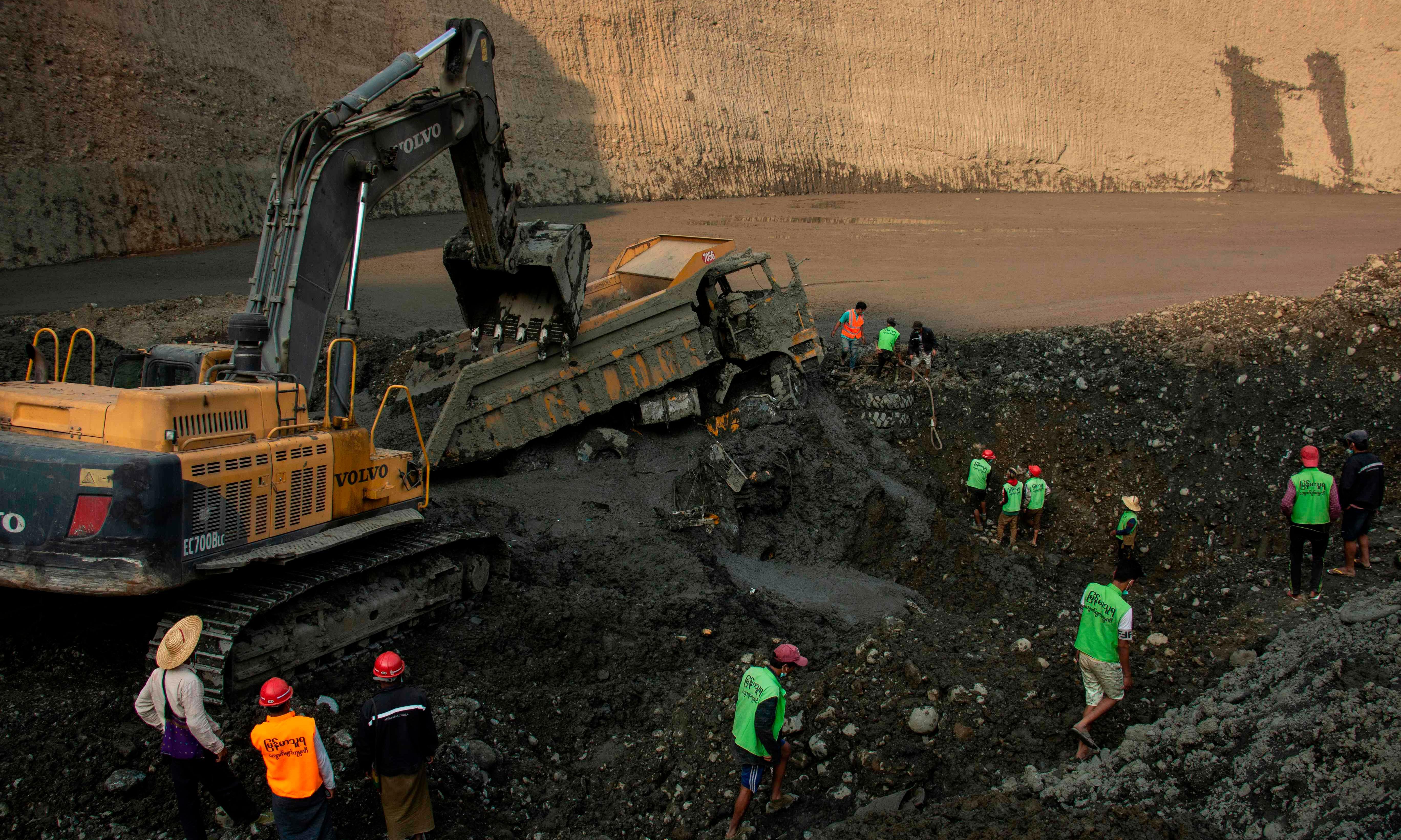 Myanmar landslide: more than 50 jade miners feared dead in 'mudlake'