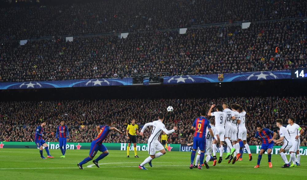Messi shoots from the free-kick.