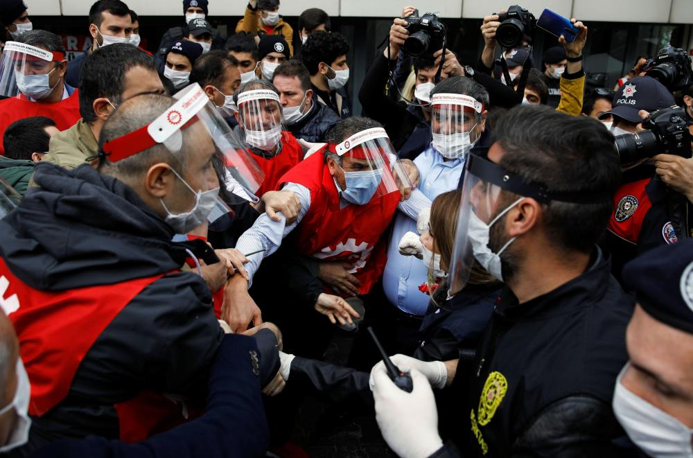 Trade unionists struggle with Turkish riot police and plainclothes officers as they attempt to defy the ban on marching on May Day