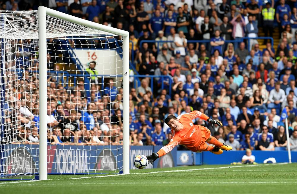 Thibaut Courtois fails to keep out Vokes' shot.