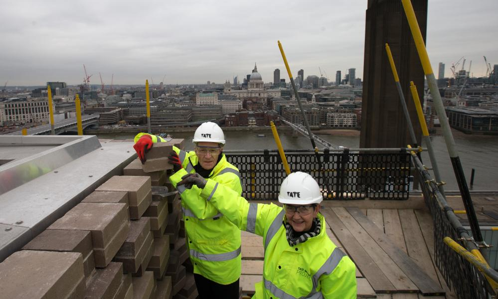 Morris with overall Tate director Sir Nicholas Serota as he lays the final brick of the new Tate Modern extension in February.