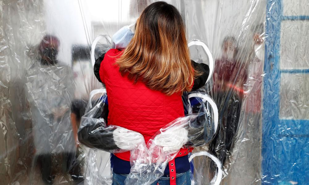 Lucia Palma embraces her 90-year-old mother Leonor through a 'hug curtain', in the city of Sao Paulo, Brazil.