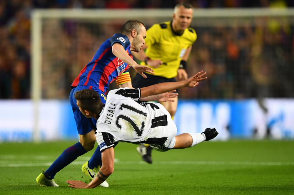 Dybala, fouled by Iniesta.
