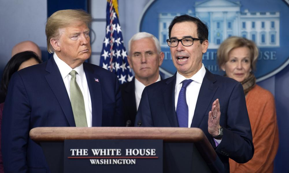 United States Secretary of the Treasury Steven Mnuchin, second right, joined by US President Donald Trump, left.