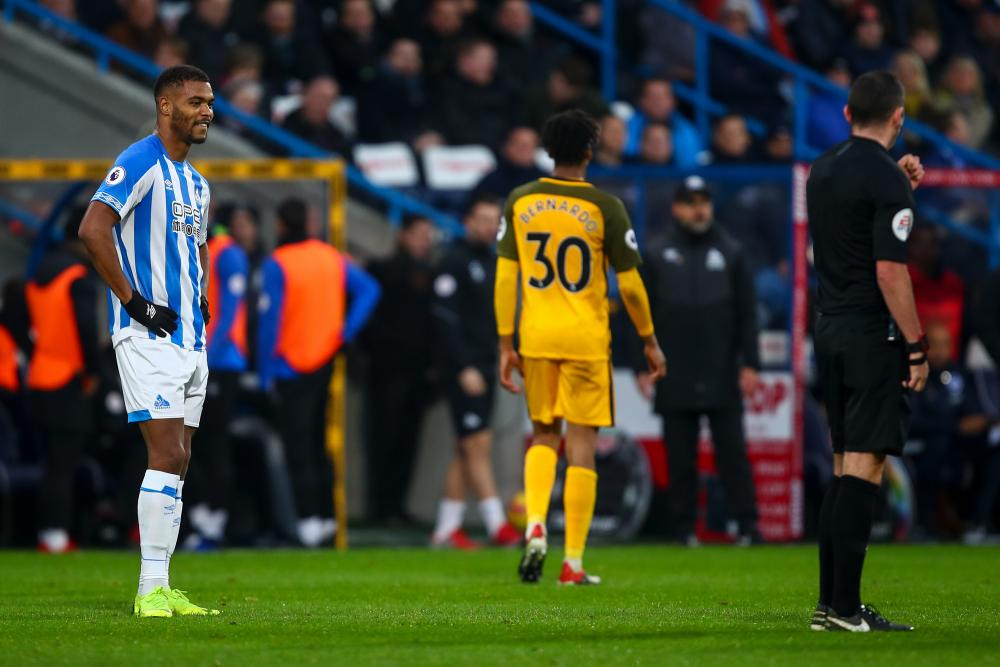 Steve Mounie reacts in disbelief after receiving a straight red.