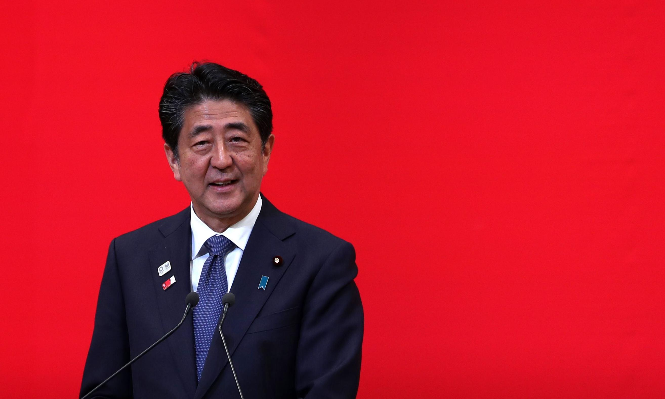 Shinzo Abe weathers scandals to become Japan's longest-serving prime minister