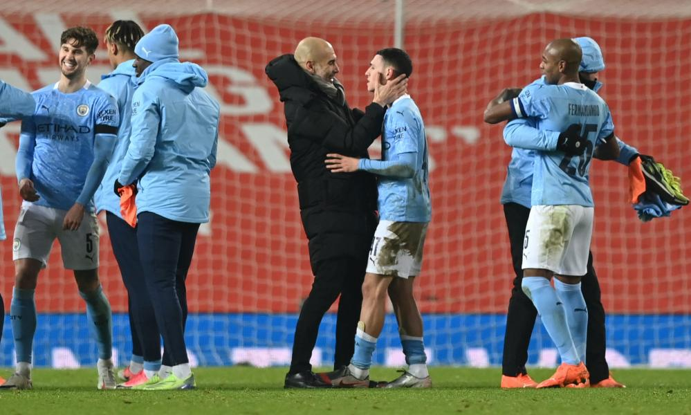 Manchester City manager Pep Guardiola celebrates the victory with Phil Foden.