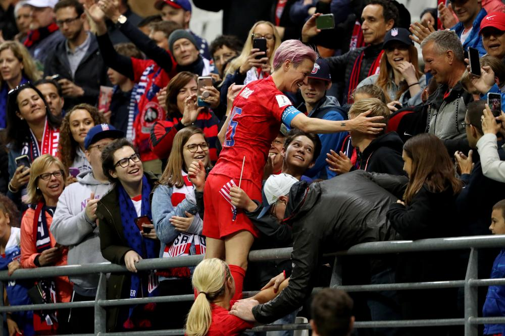 Megan Rapinoe celebrates the rout with her family and friends.