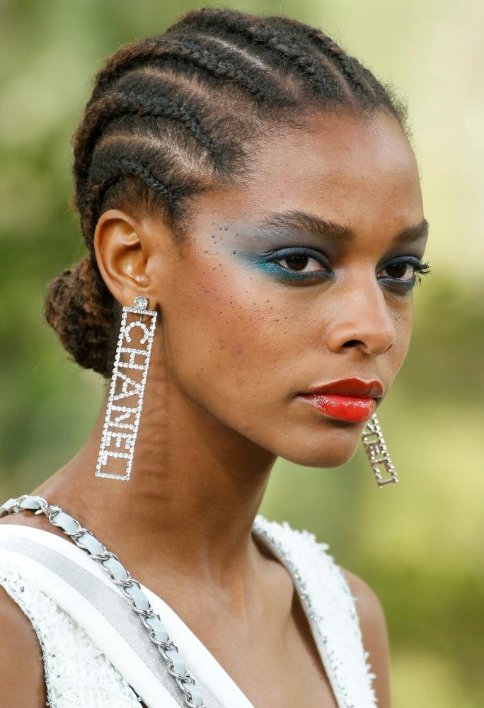 Bold makeup with elegant cornrows.