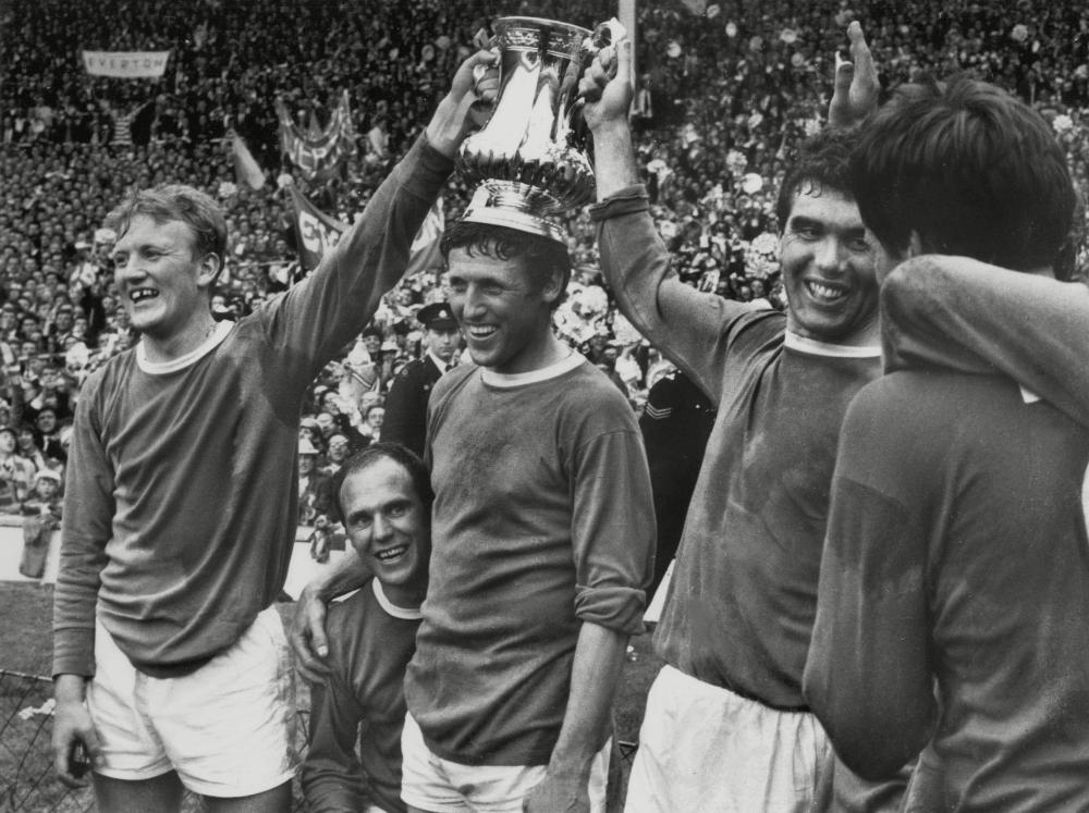 Ray Wilson, second from left, and Everton players Jimmy Gabriel, Brian Harris and Alex Scott celebrate beating Sheffield Wednesday in the FA cup final, 1966.