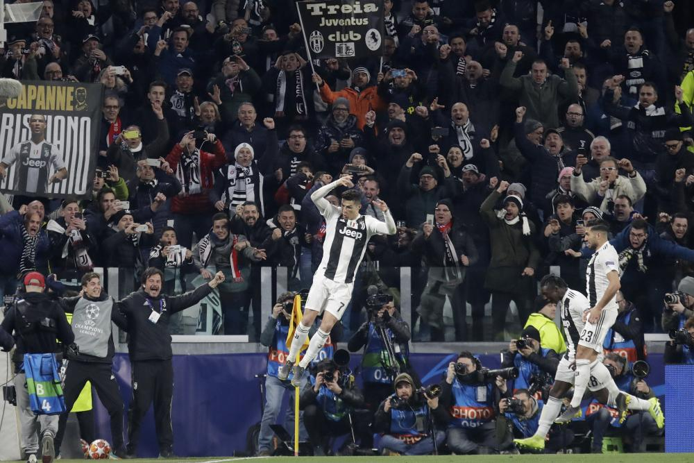 Juventus' Cristiano Ronaldo celebrates after scoring their third goal.