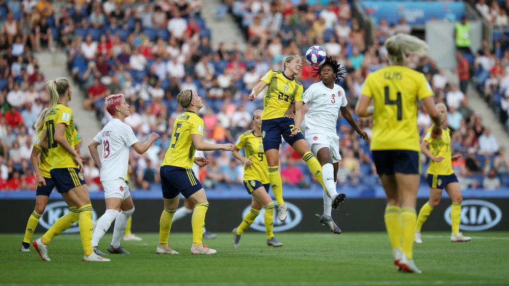 Elin Rubensson of Sweden battles for possession in the air with Canada's Kadeisha Buchanan.