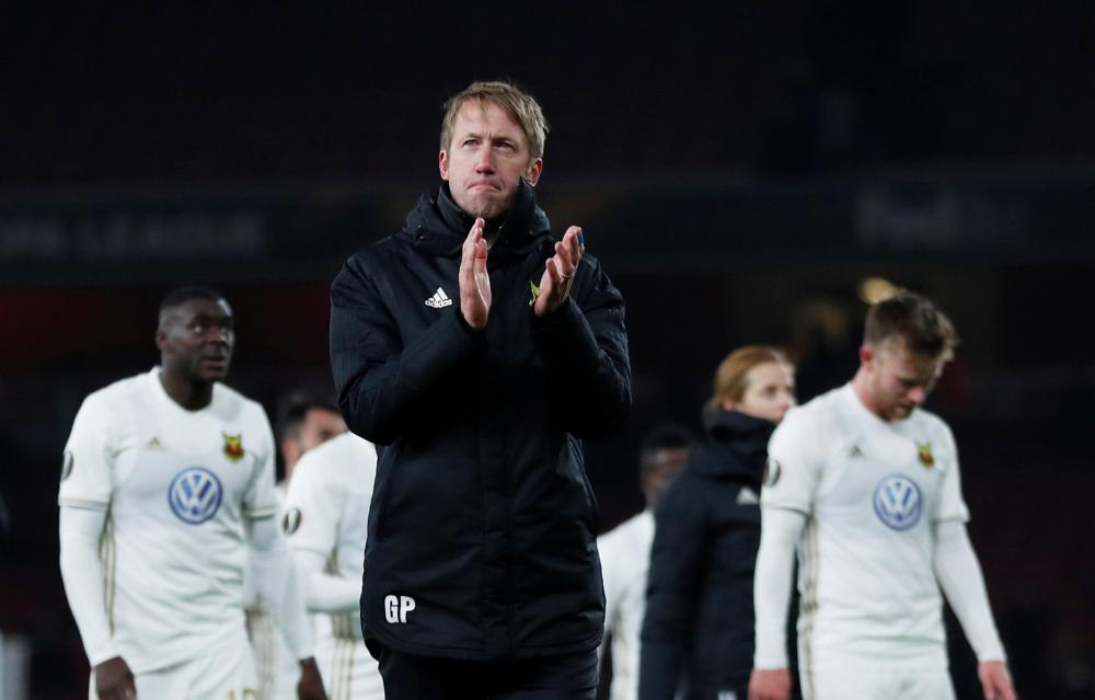Graham Potter applauds the fans at the end of the match.