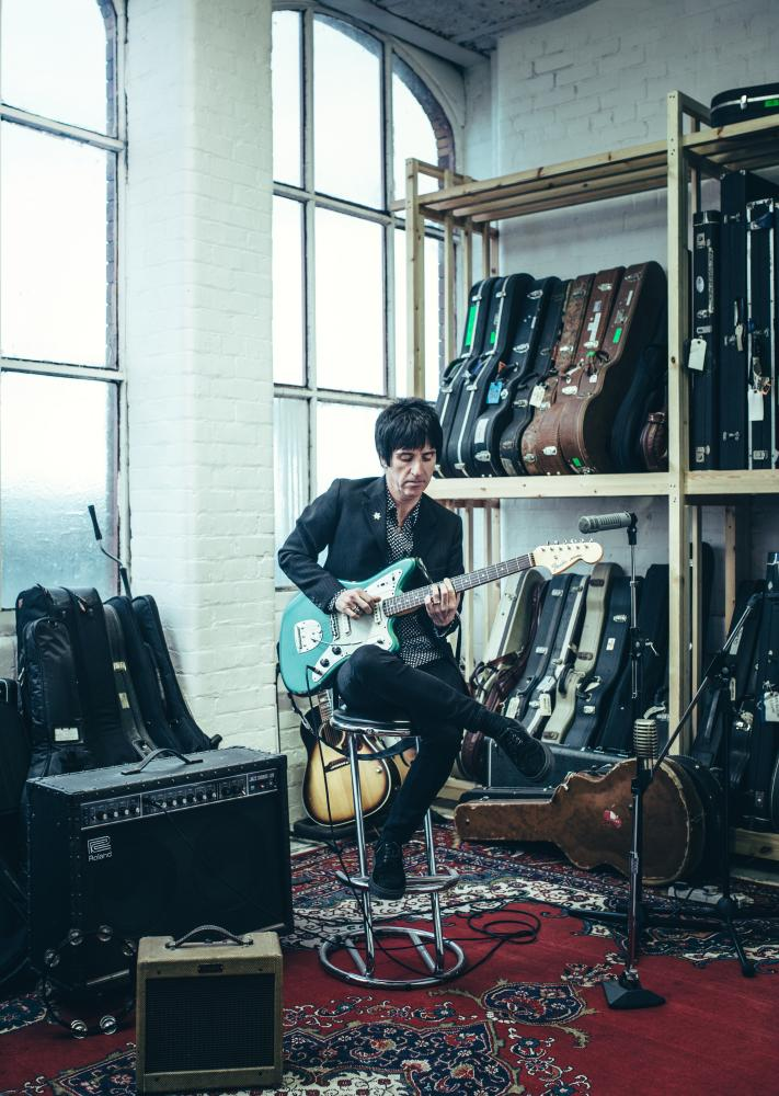 Johnny Marr playing his guitar