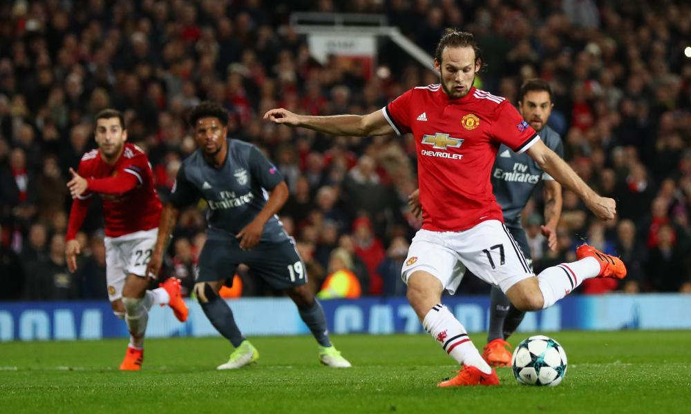 Daley Blind slots home the penalty.