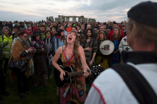 Revellers celebrate the summer solstice at Stonehenge in Wiltshire