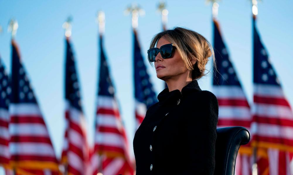 Melania Trump listening to her husband in January, shortly before he stood down as president.