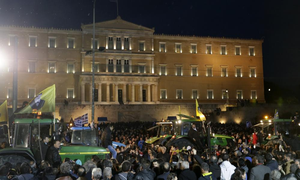 Farmers drive their tractors in front of the Greek parliament.