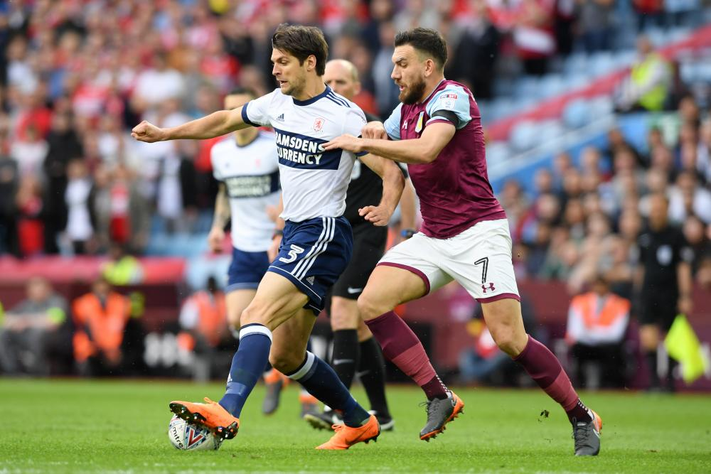 George Friend of Middlesbrough battles for possession with Villa's Robert Snodgrass.