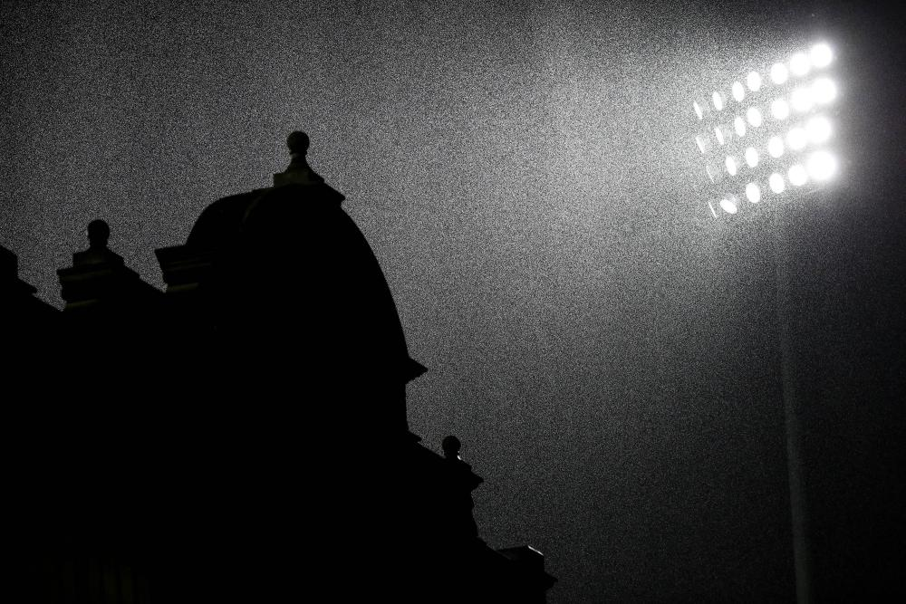 A turret at Craven Cottage is silhouetted against the heavy rain.