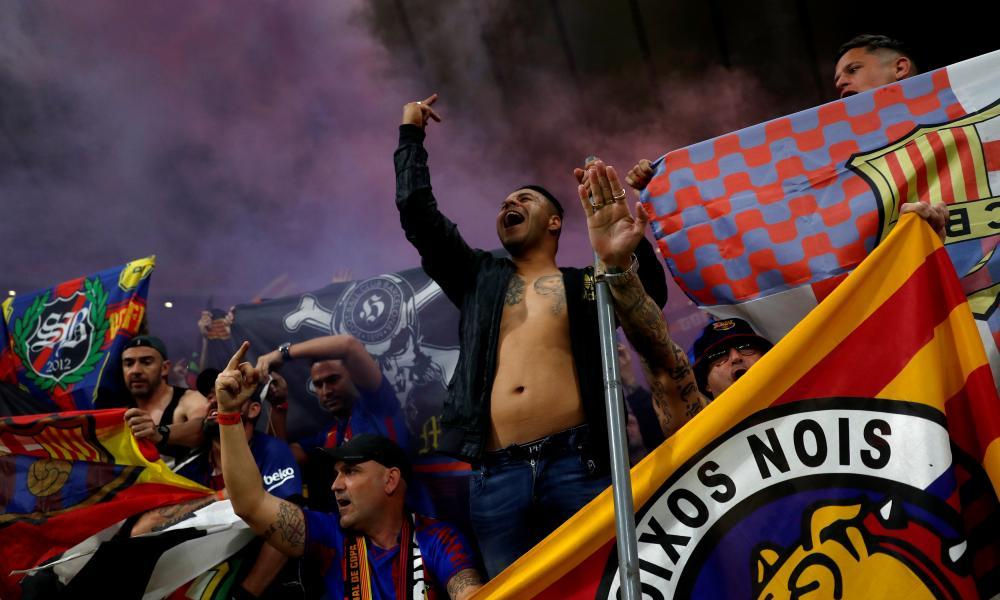 A Barcelona fan gets in the mood.