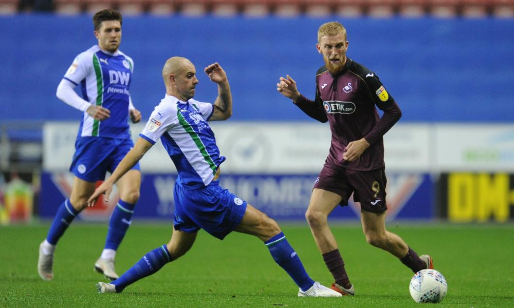 Oli McBurnie, in action here against Wigan, says: 'Obviously the way I look is not the way that everybody else looks on the pitch.'