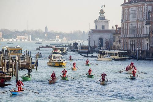 Rowers dressed as Santa take part in the seventh annual Father Christmas regatta organised by Ca' Foscari University on the Grand Canal in Venice