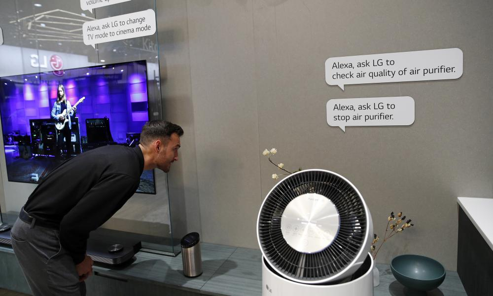 An employee demonstrates home appliances that can be controlled by Amazon Alexa at the LG booth during CES.