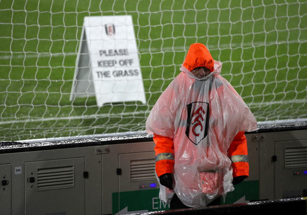 December 15: A steward in a rain poncho before the Premier League match at Craven Cottage between Fulham and West Ham United.