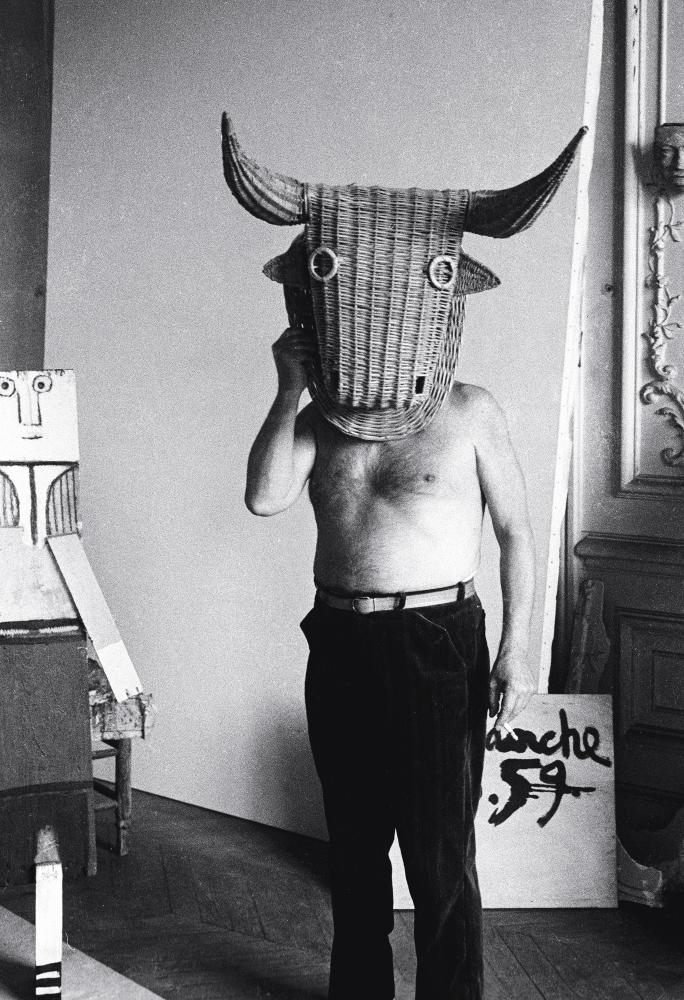 Picasso dressed in a wicker bull head, for training matadors.
