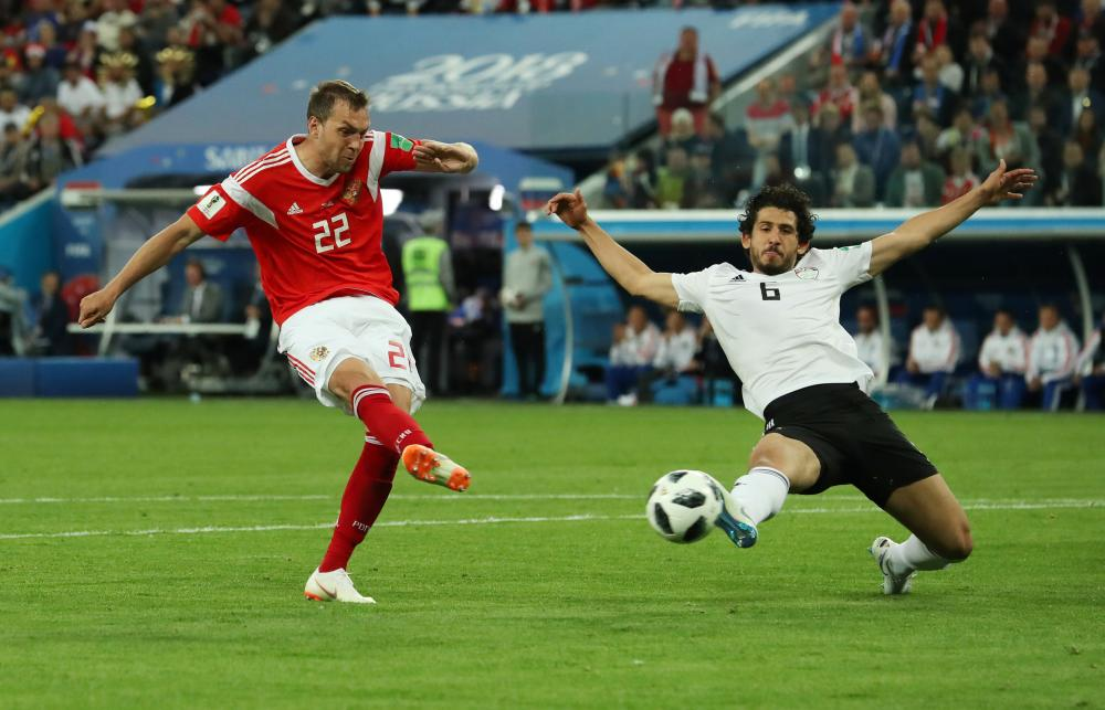 Russia's Artem Dzyuba slams home their third goal.