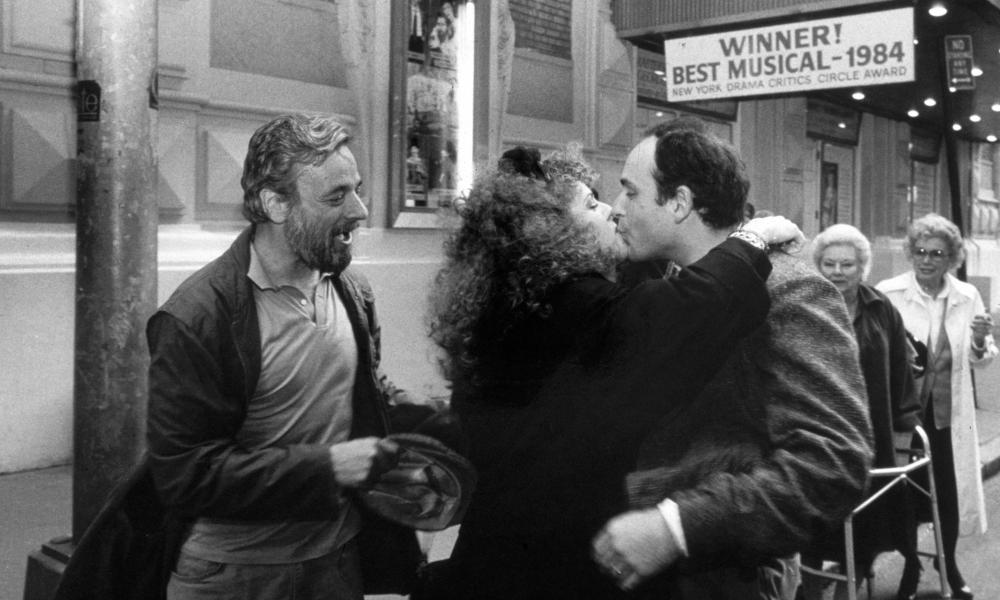Stephen Sondheim, left, looks on as Bernadette Peters kisses playwright James Lapine after Sunday in the Park With George won the Pulitzer prize, April 1985