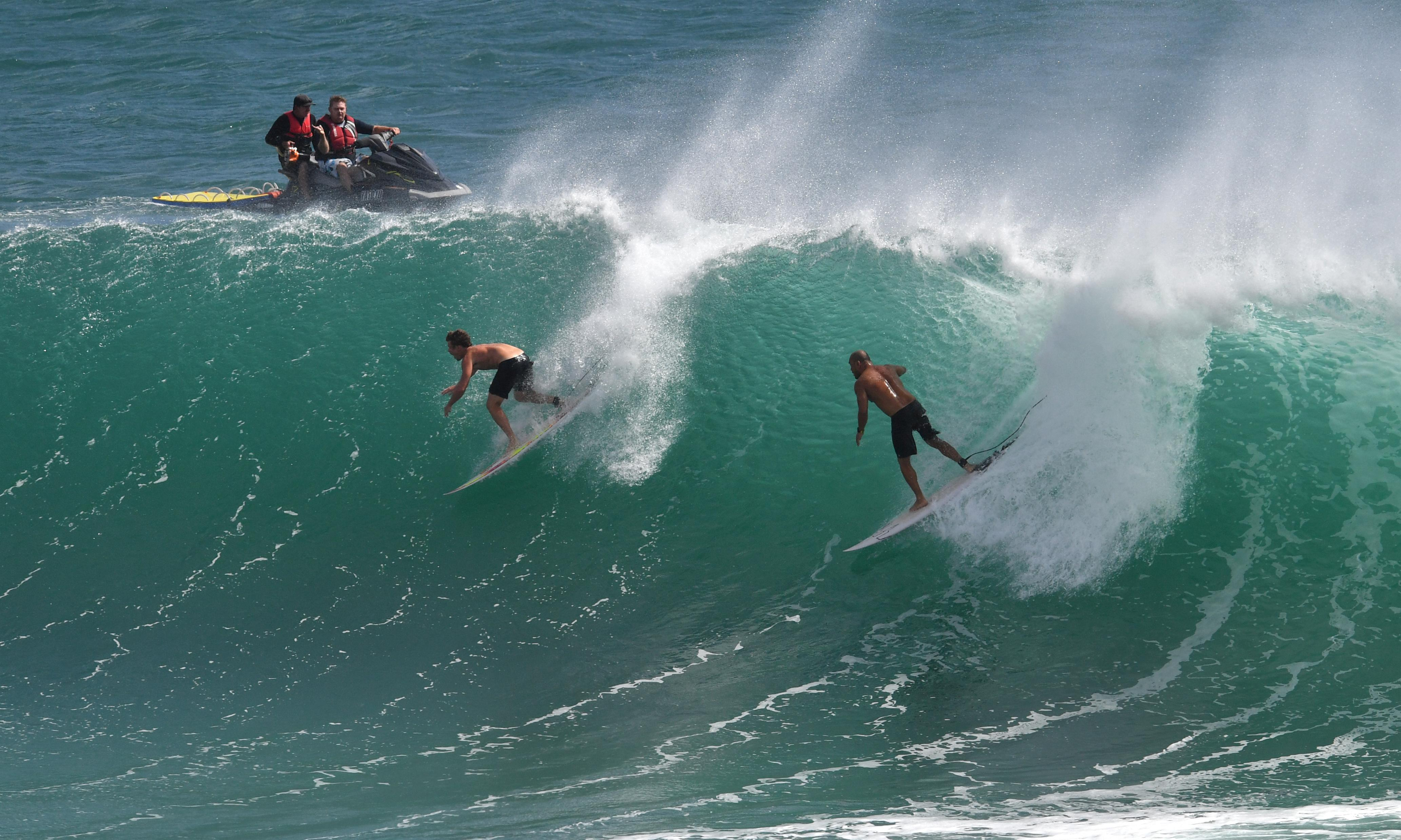 Cyclone Oma: surfers enjoy wild swell but downgraded storm could yet intensify