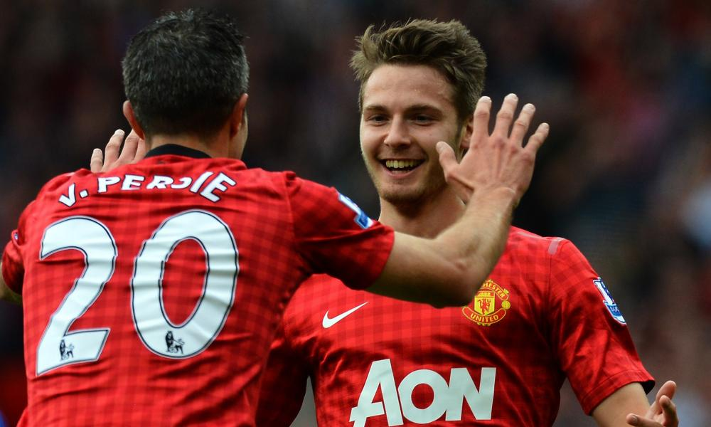Nick Powell celebrates with Robin van Persie after scoring on his Premier League debut in 2012.