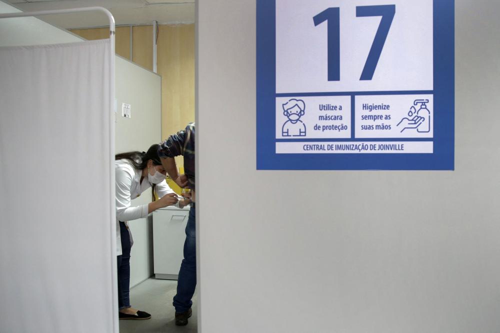 A man receives a Covid vaccine at a health centre in Joinville, Santa Catarina.