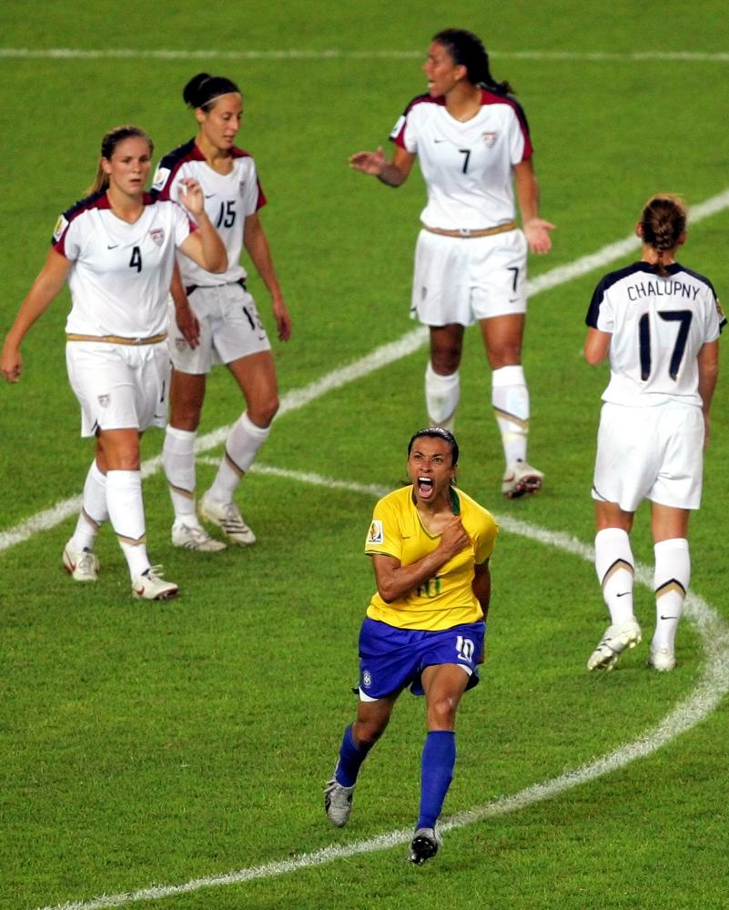 Shannon Boxx (No 7), pictured after Marta scored in the 2007 World Cup semi-final between USA and Brazil.