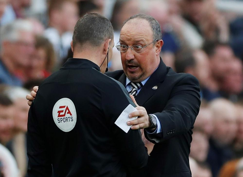 Newcastle United manager Rafael Benitez protests with a match official.