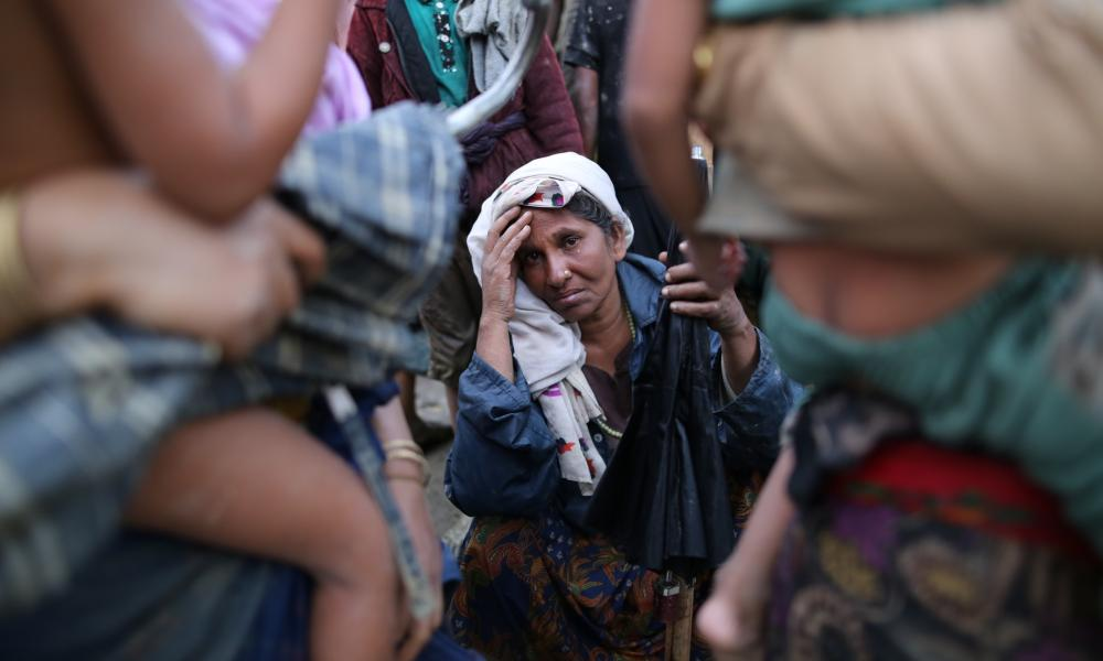 A Rohingya woman rests after fleeing Myanmar for Bangladesh