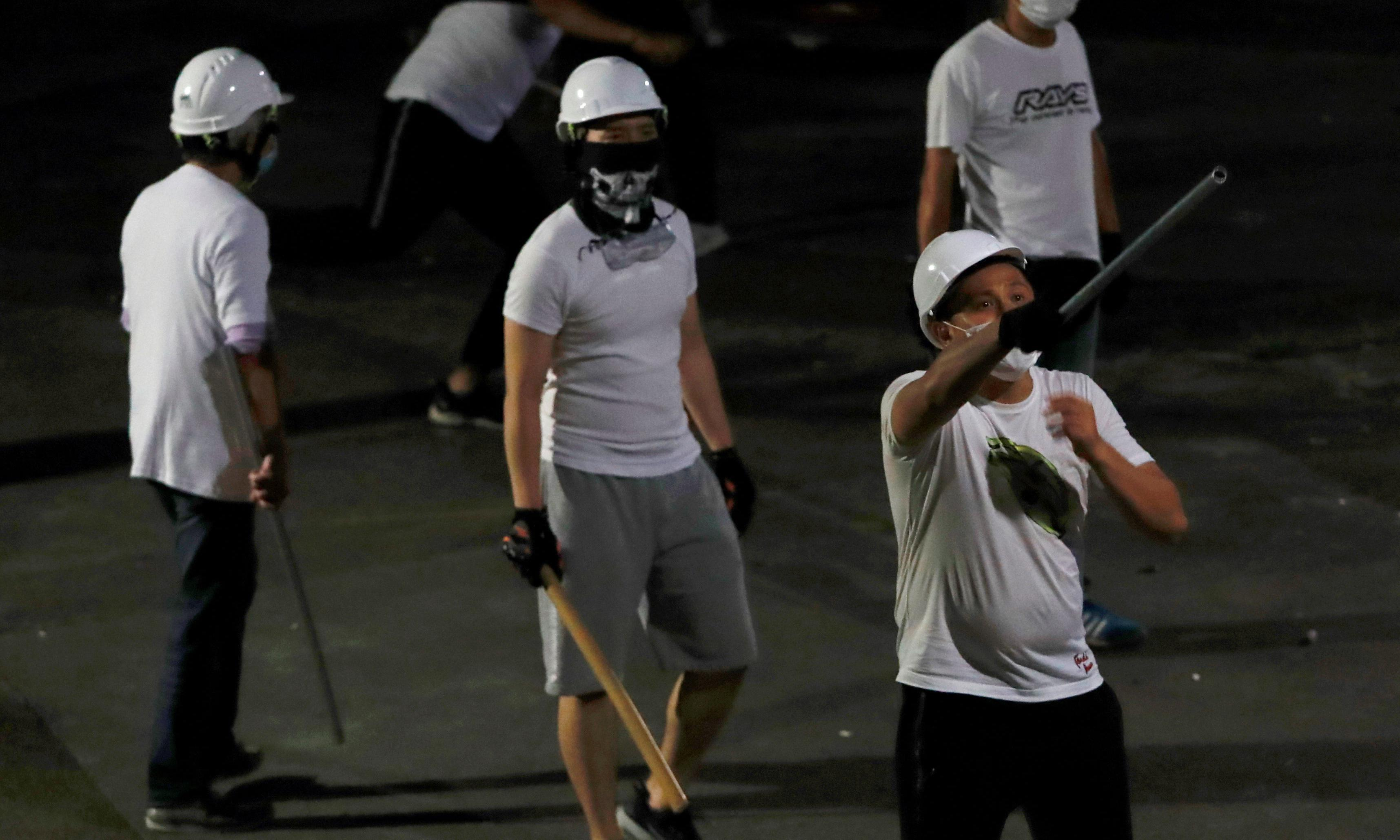 Hong Kong protesters pledge to stand up to thugs after attack