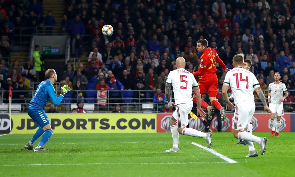 Aaron Ramsey rises to give Wales the lead from Gareth Bale's cross.