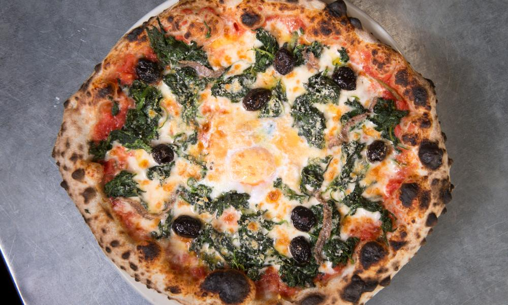 spinach, olive and free range egg pizza.