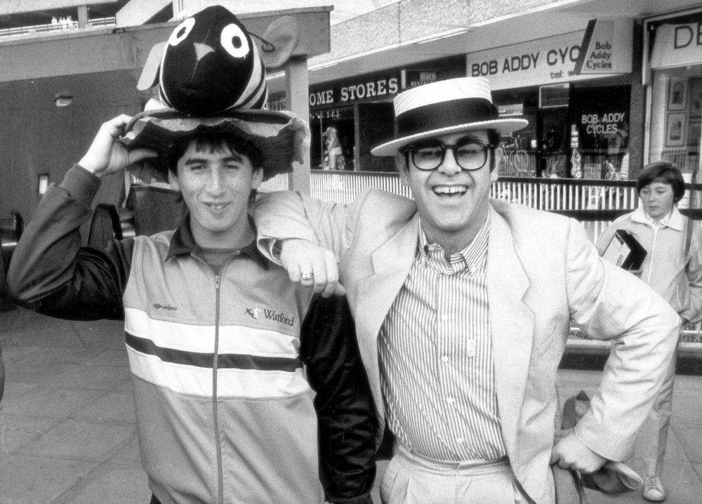 Nigel Callaghan with Elton John, then Watford's chairman and now the club's honorary life-president, at a Watford shopping precinct in May 1984.
