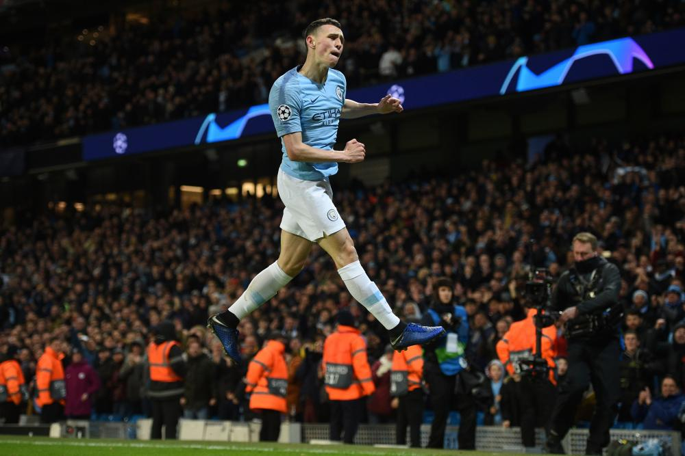 Manchester City's Phil Foden celebrates after scoring their sixth goal.