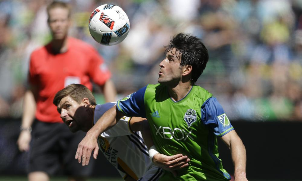 Nicolás Lodeiro, right, outmuscles LA Galaxy's Steven Gerrard.
