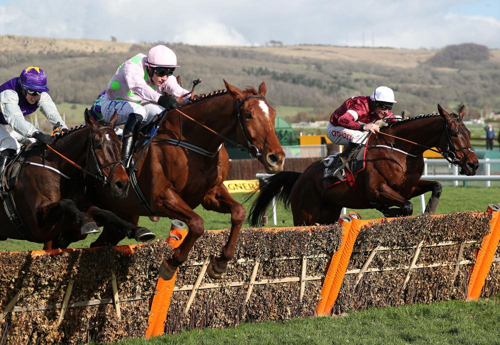 Monkfish ridden by Paul Towned (centre) jumps the last on the way to winning the Albert Bartlett Novices' Hurdle.