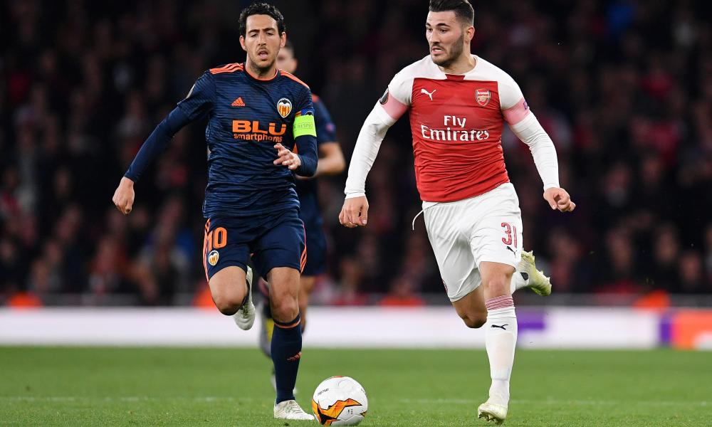 Parejo chases Arsenal's Sead Kolasinac during last week's semi-final first leg. Valencia trail 3-1 going into Thursday's second leg at the Mestalla.