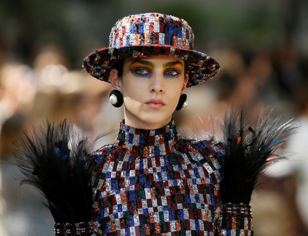 Plumed shoulders and a long-layered shift dress at Chanel.