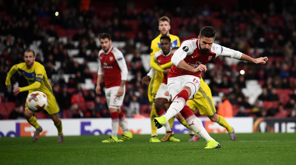 Arsenal's Olivier Giroud scores their fifth goal from the penalty spot.