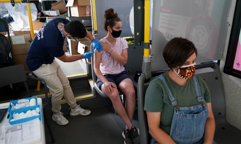 Sophie Edmondson receives a dose of a Covid-19 vaccine on board a vaccination bus at the Latitude festival in Henham Park, Southwold, Suffolk.
